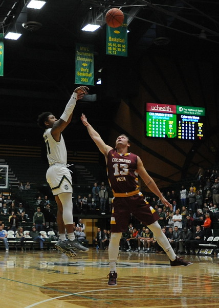 Colorado State's Prentiss Nixon shoots over Colorado Mesa's Brandon Hoffer on Friday night at Moby Arena.