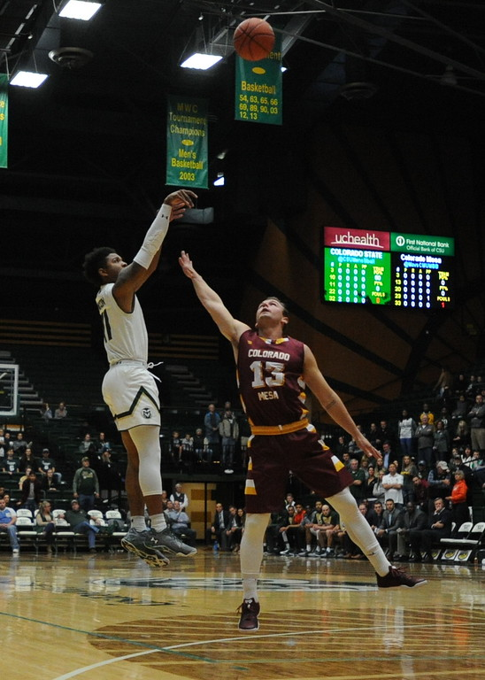 . Colorado State\'s Prentiss Nixon shoots over Colorado Mesa\'s Brandon Hoffer on Friday night at Moby Arena.