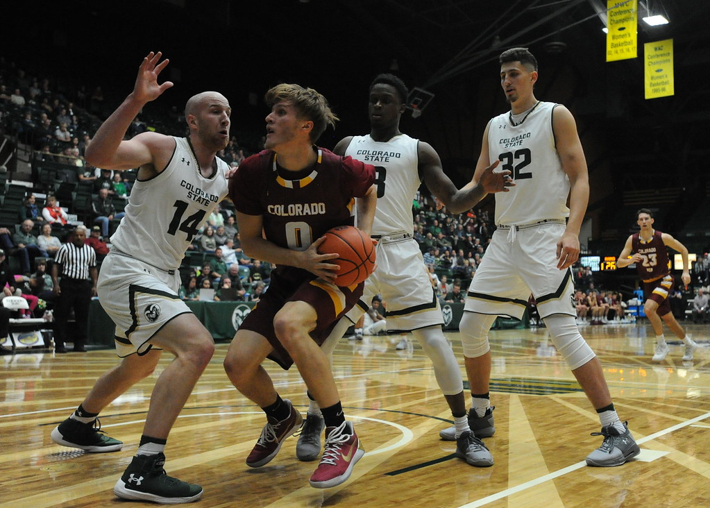 . Colorado Mesa\'s Michael Skinner (0) is defended by Colorado State\'s Robbie Berwick (14), Raquan Mitchell (3) and Nico Carvacho (32) on Friday night at Moby Arena.