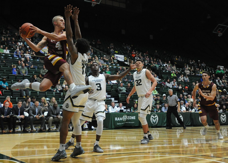 Colorado Mesa's Trent Clay (4) is defended by Colorado State's Prentiss Nixon on Friday at Moby Arena in Fort Collins.