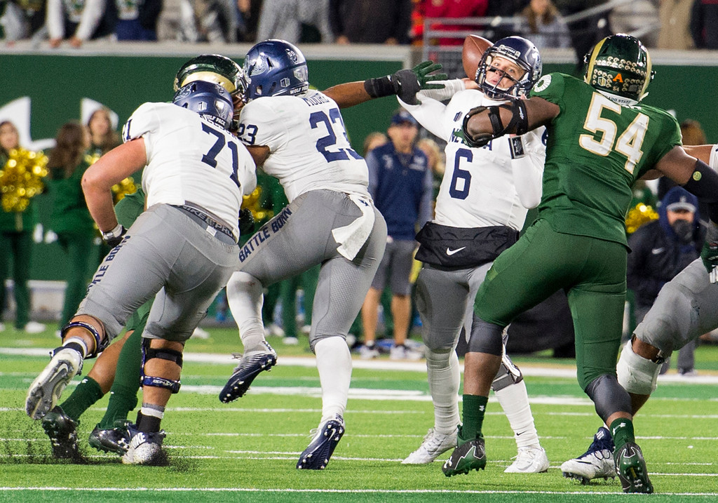 . Colorado State linebacker Josh Watson (55) gets past Nevada\'s Jake Nelson (71) and Kelton Moore (23) to get his hand on quarterback Ty Gangi\'s (6) throwing elbow to stop the final pass of a comeback attempt late in the fourth quarter Saturday evening Oct. 14, 2017 at the CSU Stadium in Fort Collins. The Rams prevailed over the Wolf Pack, 44-42. (Michael Brian/For the Reporter-Herald)