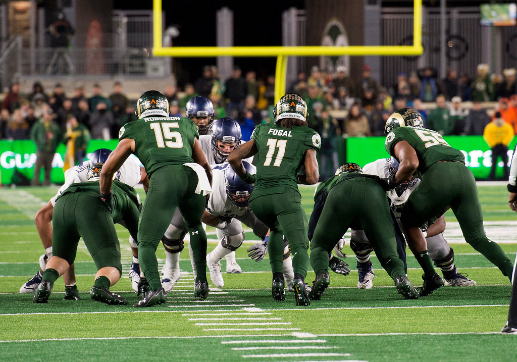 . The Colorado State defense attacks the line of scrimmage as Nevada attempts a quarterback sneak in the fourth quarter Saturday evening Oct. 14, 2017 at the CSU Stadium in Fort Collins. (Michael Brian/For the Reporter-Herald)