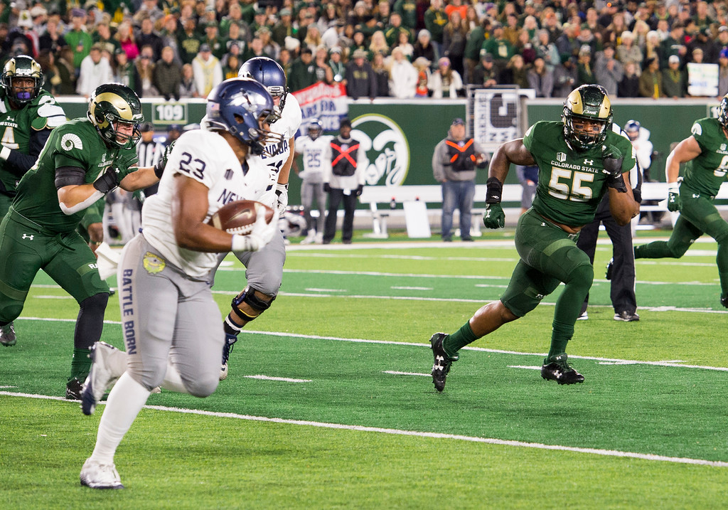 . Colorado State linebacker Josh Watson (55) tracks Nevada running back Kelton Moore (23) in early action Saturday evening Oct. 14, 2017 at the CSU Stadium in Fort Collins. (Michael Brian/For the Reporter-Herald)