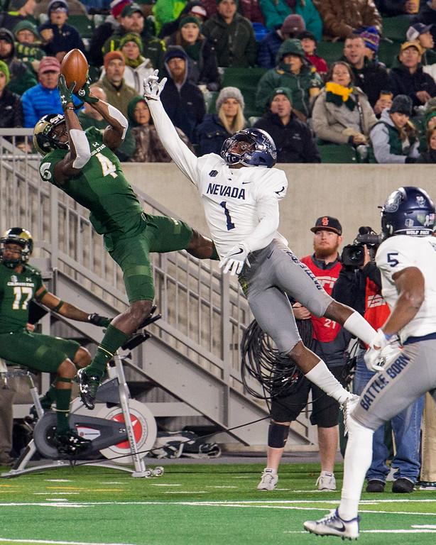 . Colorado State wide receiver Michael Gallup (4) grabs a leaping catch against Nevada\'s Vosean Crumbie (1) during first-half action Saturday evening Oct. 14, 2017 at the CSU Stadium in Fort Collins. (Michael Brian/For the Reporter-Herald)