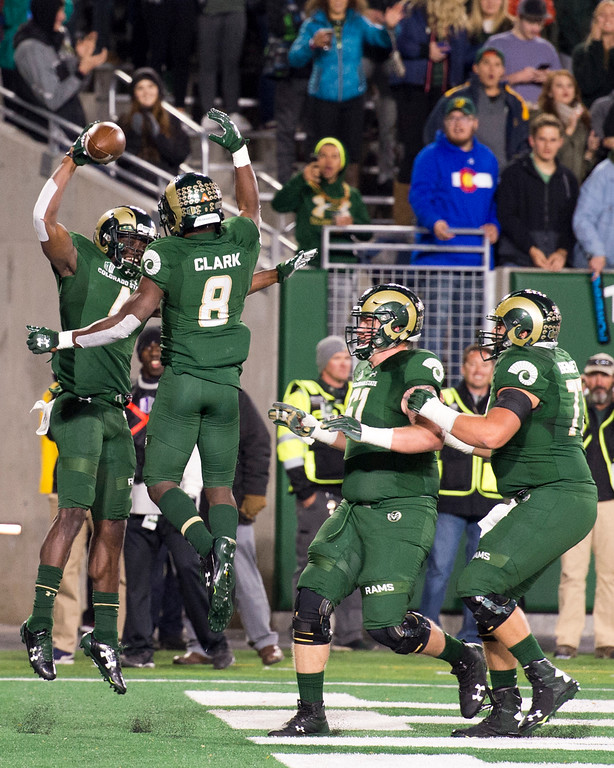 . Colorado State wide receiver Michael Gallup (4), left, celebrates his second touchdown against Nevada with teammates Detrich Clark (8), Zack Golditch (61), and Nicho Garcia (77) Saturday evening Oct. 14, 2017 at the CSU Stadium in Fort Collins. (Michael Brian/For the Reporter-Herald)