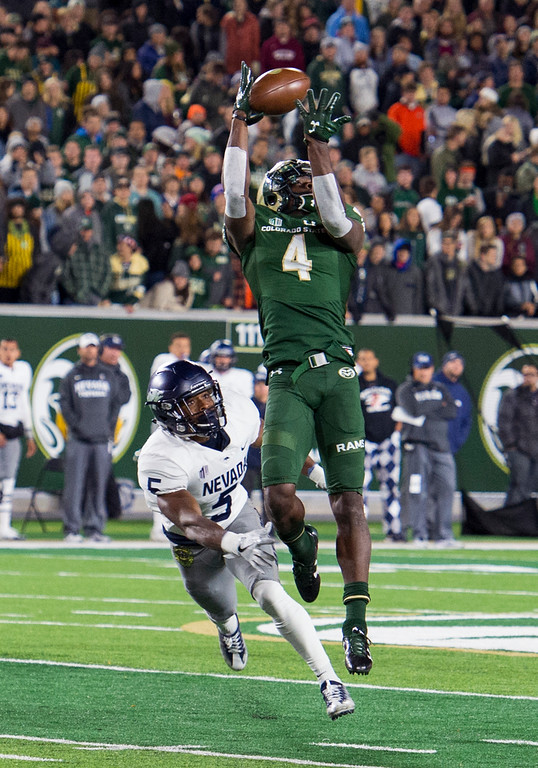 . Colorado State wide receiver Michael Gallup (4) snags a pass he would take to the end zone for a touchdown against Nevada in early action Saturday evening Oct. 14, 2017 at the CSU Stadium in Fort Collins. (Michael Brian/For the Reporter-Herald)