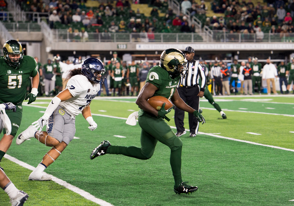 . Colorado State running back Dalyn Dawkins (1) breaks loose for a big fourth-quarter run against Nevada in early action Saturday evening Oct. 14, 2017 at the CSU Stadium in Fort Collins. The Rams beat the Wolf Pack 44-42. (Michael Brian/For the Reporter-Herald)