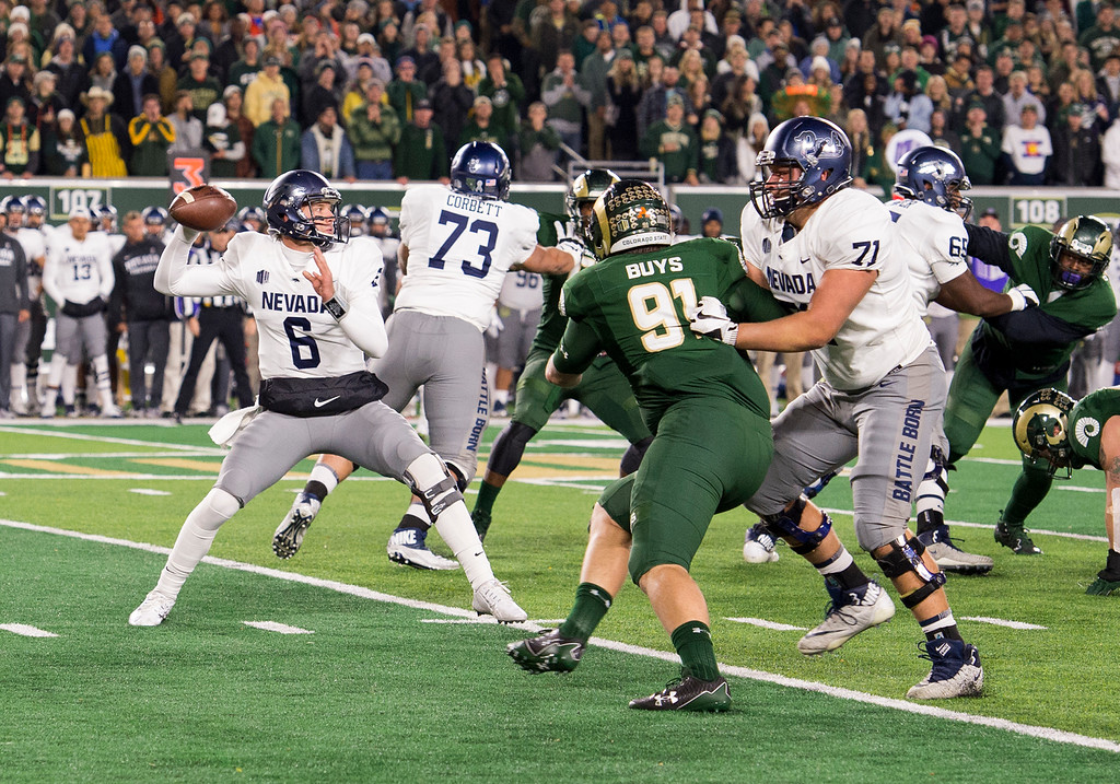 . Colorado State defenisve lineman Jacob Buys (91) fights to get to Nevada quarterback Ty Gangi (6) in early action Saturday evening Oct. 14, 2017 at the CSU Stadium in Fort Collins. (Michael Brian/For the Reporter-Herald)