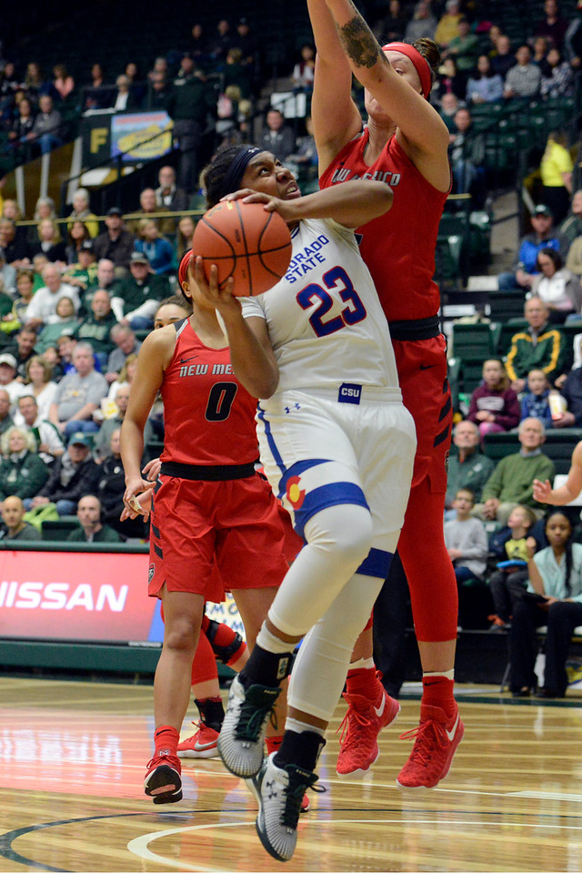Colorado State guard Grace Colaivalu goes up for a shot against New Mexico defender Tesha Buck on Saturday at Moby Arena. (Sean Star/Loveland Reporter-Herald)
