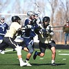 Monarch's Bryce Mayemura and Robert Brazanskas sandwich a Columbine attackman on Friday, March 16, at Monarch High School.