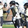 The Monarch boys lacrosse team congratulates senior midfielder Jared Hodell on a first-quarter goal against No. 4 Columbine on Friday, March 16, at Monarch High School.