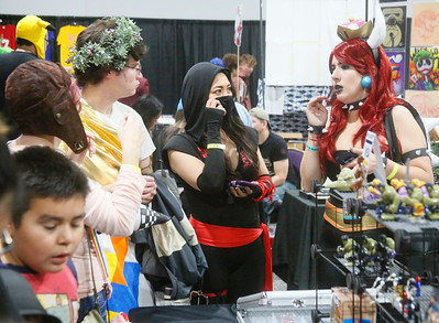 ComicCon attendees wander amid the vendor aisles at the Blue Lake Casino on Saturday. (Shaun Walker -- The Times-Standard)