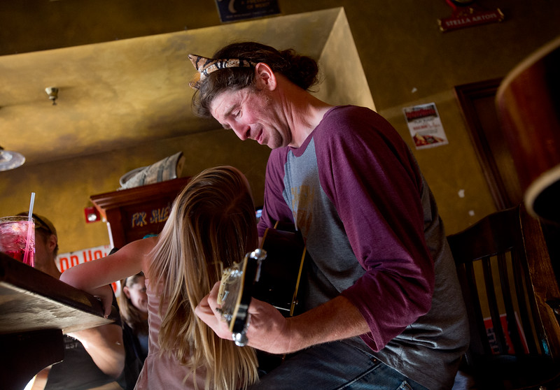 "Troy Clayton plays guitar with friends as his daughter Magnolia Clayton, 4, sits on his lap at Conor O'Neill's Irish Pub in Boulder on Sunday. The pub announced they're closing next Sunday, after 17 years in business. <br /> More photos:  <a href=""http://www.dailycamera.com"">http://www.dailycamera.com</a><br /> (Autumn Parry/Staff Photographer)<br /> September 25, 2016"