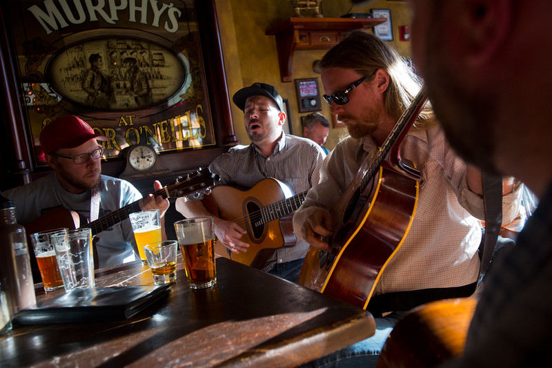 "Chris Addison (center) plays the guitar and sings with Matt Johnson (right) and Bill Huston (left) at Conor O'Neill's Irish Pub in Boulder on Sunday. The pub announced they're closing next Sunday, after 17 years in business. <br /> More photos:  <a href=""http://www.dailycamera.com"">http://www.dailycamera.com</a><br /> (Autumn Parry/Staff Photographer)<br /> September 25, 2016"
