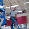 "Colby Smith, owner of A Colby Electric, helps Matthew Fulton, an electrical apprentice, set up track lighting at the new Lucky's Market on S. Broadway in Boulder on Wednesday. Lucky's Market is scheduled to open August 10th. <br /> More photos:  <a href=""http://www.dailycamera.com"">http://www.dailycamera.com</a><br /> (Autumn Parry/Staff Photographer)<br /> July 13, 2016"
