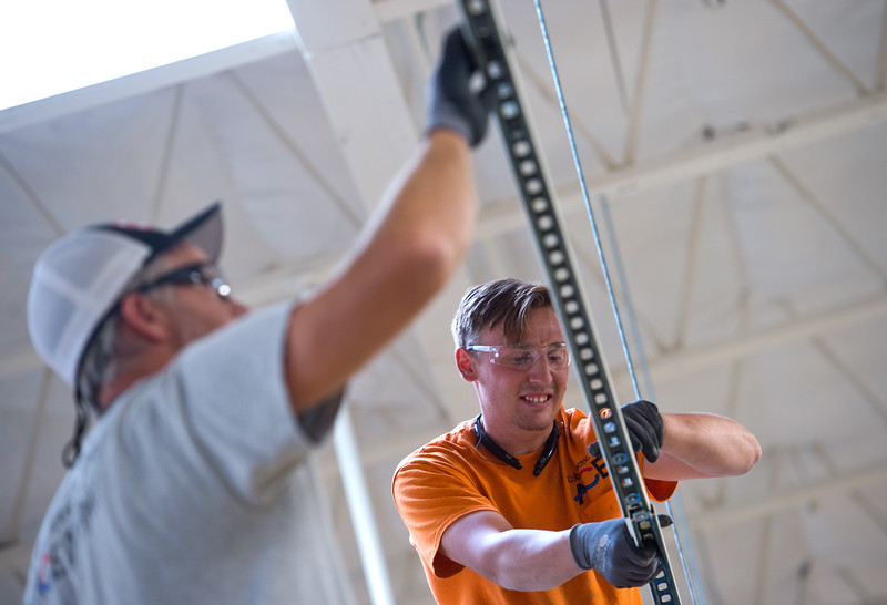 "Colby Smith, owner of A Colby Electric, and Matthew Fulton, an electrical apprentice, set up track lighting at the new Lucky's Market on S. Broadway in Boulder on Wednesday. Lucky's Market is scheduled to open August 10th. <br /> More photos:  <a href=""http://www.dailycamera.com"">http://www.dailycamera.com</a><br /> (Autumn Parry/Staff Photographer)<br /> July 13, 2016"