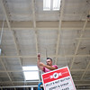 "Jason Lipnitzky, a production technician with Photo Craft, hangs signs in the aisles of the new Lucky's Market on S. Broadway in Boulder on Wednesday. Lucky's Market is scheduled to open August 10th. <br /> More photos:  <a href=""http://www.dailycamera.com"">http://www.dailycamera.com</a><br /> (Autumn Parry/Staff Photographer)<br /> July 13, 2016"