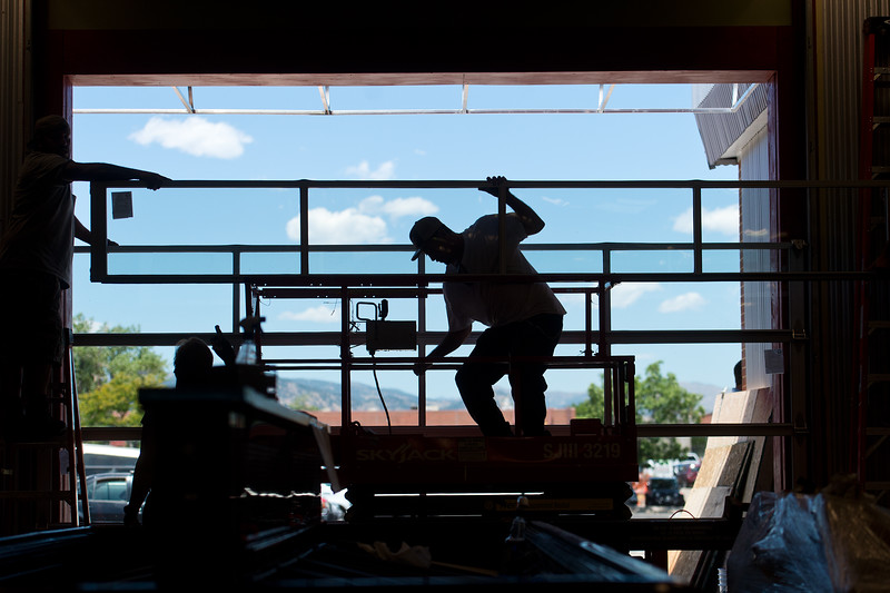 "David Maes, a construction worker with Lucky's Market, helps attach sliding doors at the new Lucky's Market on S. Broadway in Boulder on Wednesday. Lucky's Market is scheduled to open August 10th. <br /> More photos:  <a href=""http://www.dailycamera.com"">http://www.dailycamera.com</a><br /> (Autumn Parry/Staff Photographer)<br /> July 13, 2016"