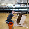 "Sean Pavack, with Labor Ready, stains furniture at the new Lucky's Market on S. Broadway in Boulder on Wednesday. Lucky's Market is scheduled to open August 10th. <br /> More photos:  <a href=""http://www.dailycamera.com"">http://www.dailycamera.com</a><br /> (Autumn Parry/Staff Photographer)<br /> July 13, 2016"