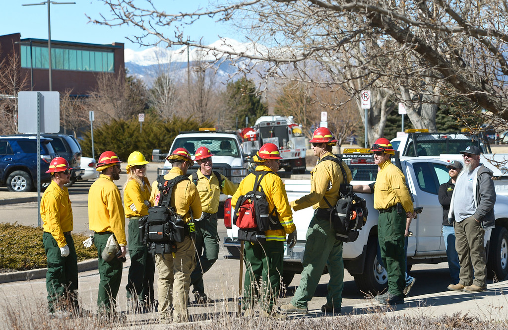 . LONGMONT, CO - MARCH 20: Firefighters and natural resources/parks and open space employees gather before a controlled burn in the pond in front of the Rec Center at the Quail Campus March 20, 2019. The cattails were burned to increase the holding capacity of the pond. Its water is used to irrigate the landscaping in the area. The cattails were not dry enough last fall when a previous controlled burn was attempted, according to information from the City of Longmont\'s web site. To view more photos visit timescall.com. (Photo by Lewis Geyer/Staff Photographer)