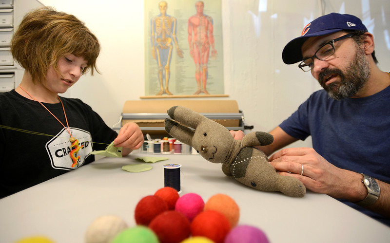 "Owyn Wyatt, 11, and Raj Chaudhari work on stuffed creatures on Tuesday morning in their downtown shop Crafted Life in Lafayette. For more photos go to  <a href=""http://www.dailycamera.com"">http://www.dailycamera.com</a><br /> <br /> Devi Chung For The Camera. June 14, 2016"