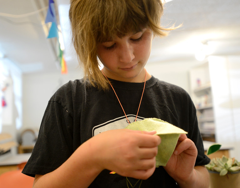 "Owyn Wyatt, 11, focuses on a craft project in Crafted Life in downtown Lafayette. For more photos go to  <a href=""http://www.dailycamera.com"">http://www.dailycamera.com</a><br /> <br /> Devi Chung For The Camera. June 14, 2016"