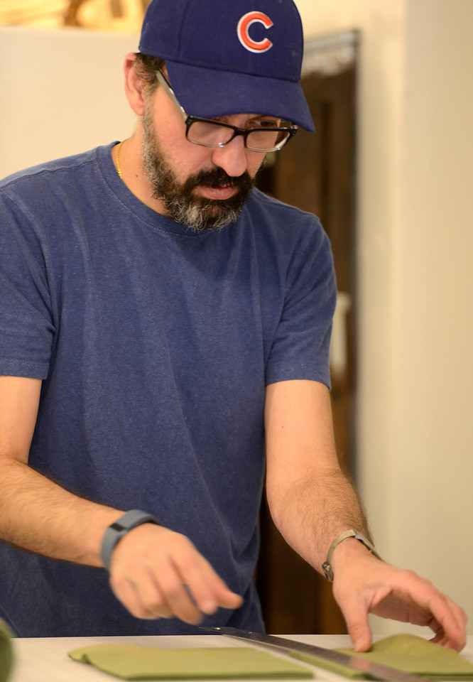 "Raj Chaudhari cuts and measures felt pieces in Crafted Life in downtown Lafayette on Tuesday morning. For more photos go to  <a href=""http://www.dailycamera.com"">http://www.dailycamera.com</a><br /> Devi Chung For The Camera. June 14, 2016"