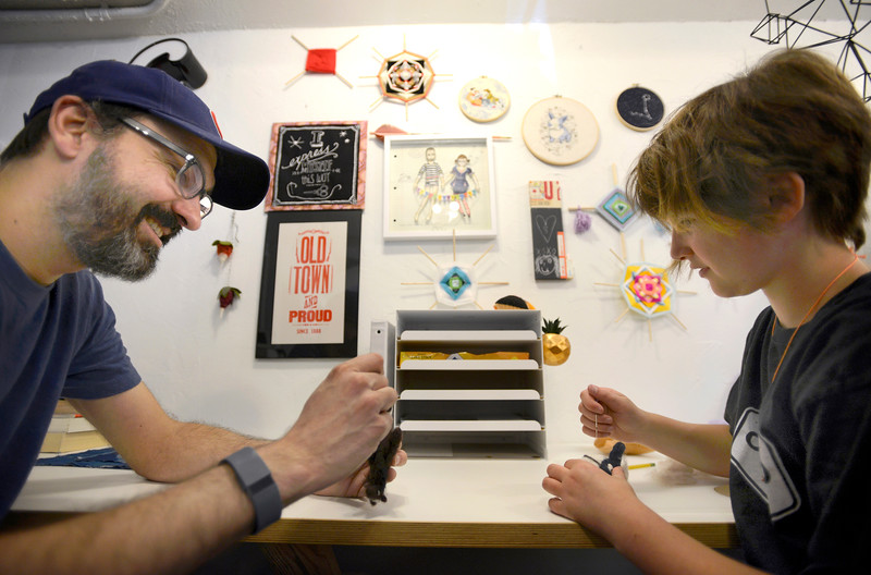 """Raj Chaudhari works on a felting project with his daughter Owyn Wyatt, 11, on Tuesday morning in their downtown shop Crafted Life in Lafayette. For more photos go to  <a href=""""http://www.dailycamera.com"""">http://www.dailycamera.com</a><br /> <br /> Devi Chung For The Camera. June 14, 2016"""