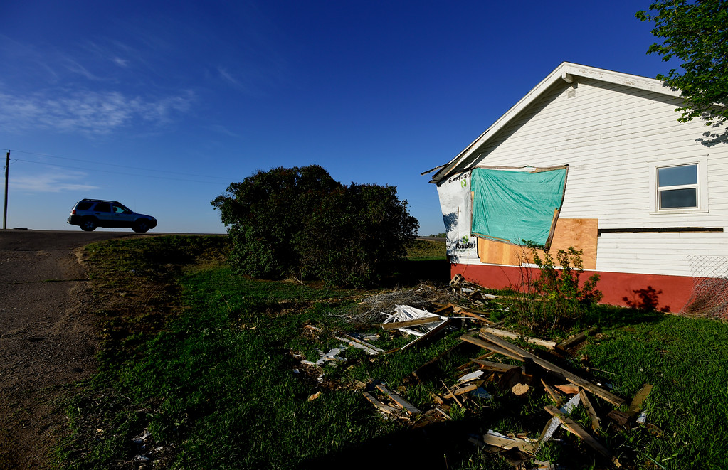 . The damaged home Vernon Peppler, 88, he grew up in off Colo. 66 is seen partially covered in tarps and plywood in Longmont on Thursday. The house was originally built around 1910 and had an additional 2 bedrooms added around 1947. The house was struck by a car on April 27, 2017 after it drove off of Colo. 66, first hitting the driveway and becoming airborne. Matthew Jonas/Staff Photographer May 11, 2017