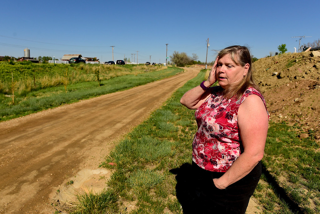 . Michelle Jordan reacts while talking about the number of recent traffic crashes on Colo. 66 at her home off Elmore Road near Longmont on Thursday. Matthew Jonas/Staff Photographer May 11, 2017