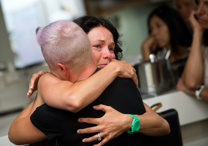 "Bri Davis hugs a friend at RallySport Health and Fitness Club in Boulder on Sunday. Davis recently lost her husband, Bill Davis, who was killed in a hit-and-run crash at 30th Street and Jay Road on Saturday.<br /> More photos:  <a href=""http://www.dailycamera.com"">http://www.dailycamera.com</a><br /> (Autumn Parry/Staff Photographer)<br /> June 26, 2016"