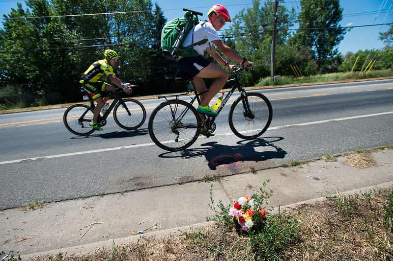 "Cyclists pass by a memorial left for 35-year-old Bill Davis who was killed in a hit-and-run crash at Jay Road and 30th Street on Saturday.<br /> More photos:  <a href=""http://www.dailycamera.com"">http://www.dailycamera.com</a><br /> (Autumn Parry/Staff Photographer)<br /> June 26, 2016"