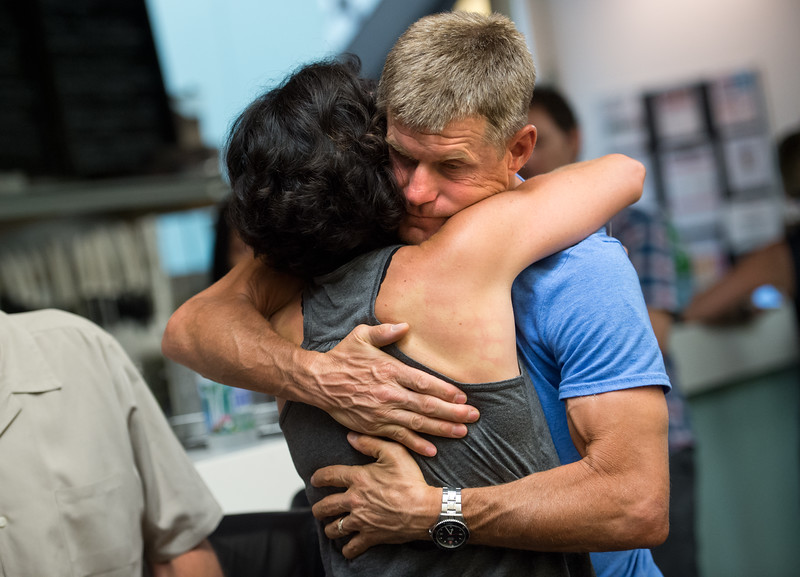 "Jeff Hoobler hugs Bri Davis at RallySport Health and Fitness Club in Boulder on Sunday. Davis' husband, Bill Davis, was killed in a hit-and-run crash at 30th Street and Jay Road on Saturday.<br /> More photos:  <a href=""http://www.dailycamera.com"">http://www.dailycamera.com</a><br /> (Autumn Parry/Staff Photographer)<br /> June 26, 2016"
