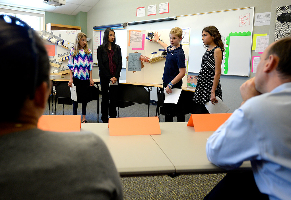 . Sixth graders from left, Anna Pedersen, 12, Anna Hullet, 12, Jake Lamb, 12, and Sydney Mei-Dan, 11, present their idea for an educational toy to a panel of business people at Alexander Dawson School on Monday.  Kira Horvath / Staff Photographer / May 2, 2016