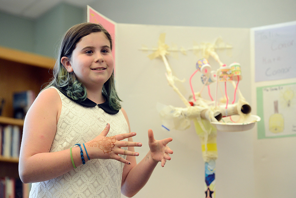 ". Sixth grader Katie Rona, 11, explains how the education toy her group created, ""The Chime Kit\"" will help children to work together at Alexander Dawson School on Monday.  Kira Horvath / Staff Photographer / May 2, 2016"