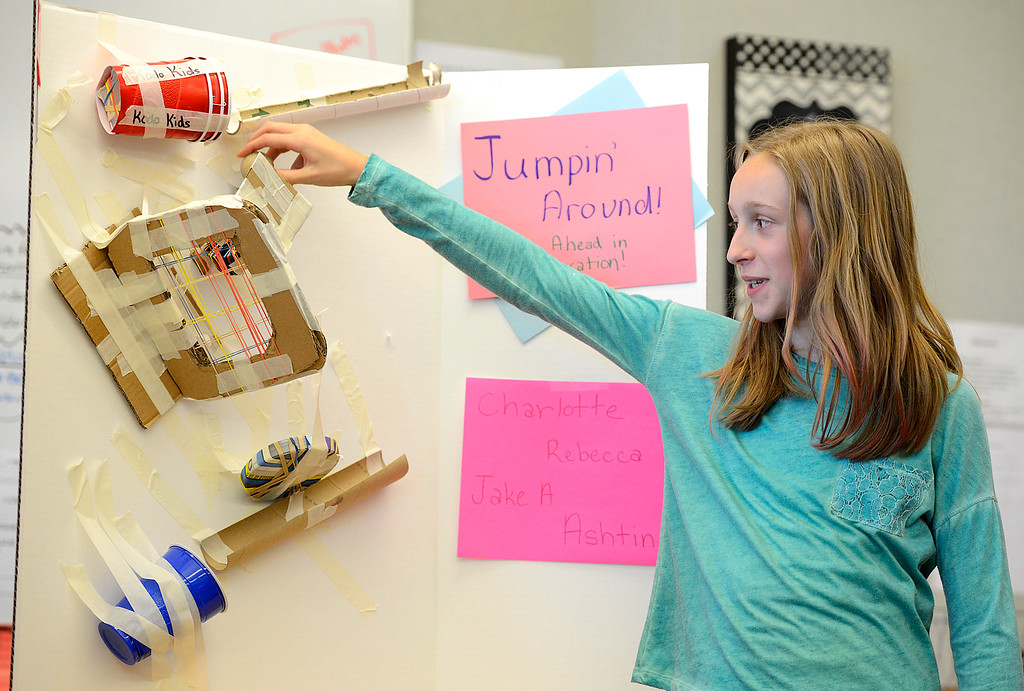 ". Sixth grader Rebecca Wells, 12, explains how the education toy her group created, ""Jumping\' Around\"" functions at Alexander Dawson School on Monday.  Kira Horvath / Staff Photographer / May 2, 2016"