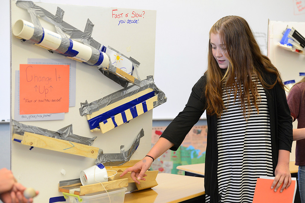 ". Sixth grader Ella Williams,11, explains how the education toy her group created, ""Change it Up\"" functions at Alexander Dawson School on Monday.  Kira Horvath / Staff Photographer / May 2, 2016"