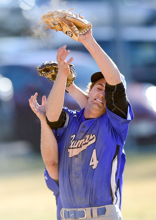 . Peak to Peak High School\'s Anthony Colgate (No. 3) and Matt Bagnato (No. 4) collide while chasing a fly ball in the game against Dawson School on Wednesday. More photos: BoCoPreps.com. Matthew Jonas/Staff Photographer March 15,  2017