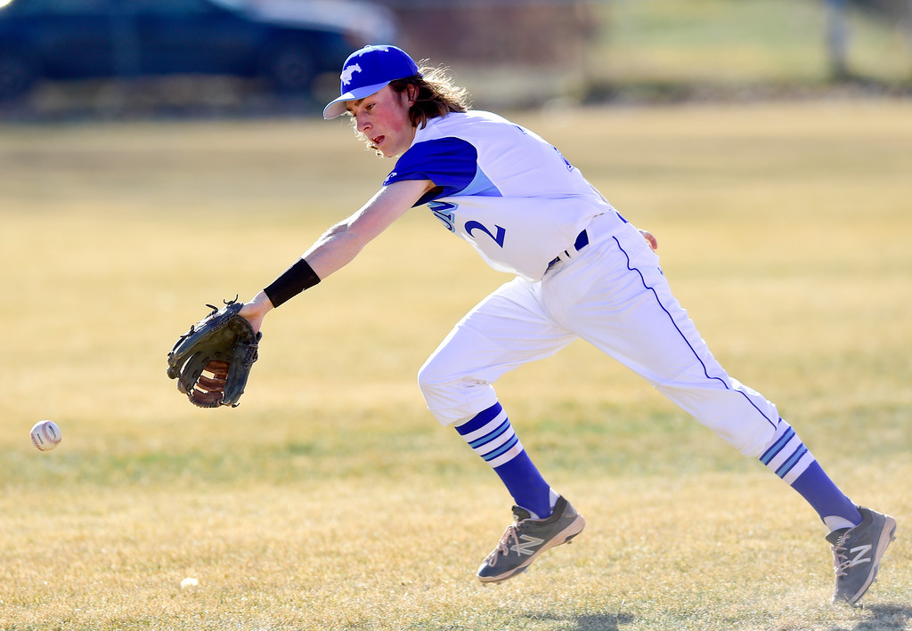 . Dawson School\'s Seth Clemente (No. 2) chases after a bouncing ball in the game against Peak to Peak High School on Wednesday. More photos: BoCoPreps.com. Matthew Jonas/Staff Photographer March 15,  2017