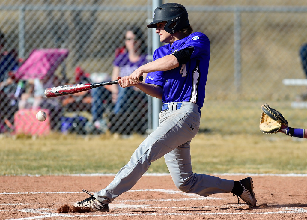 . Peak to Peak High School\'s Matt Bagnato (No. 4) gets a hit against Dawson School on Wednesday. More photos: BoCoPreps.com. Matthew Jonas/Staff Photographer March 15,  2017