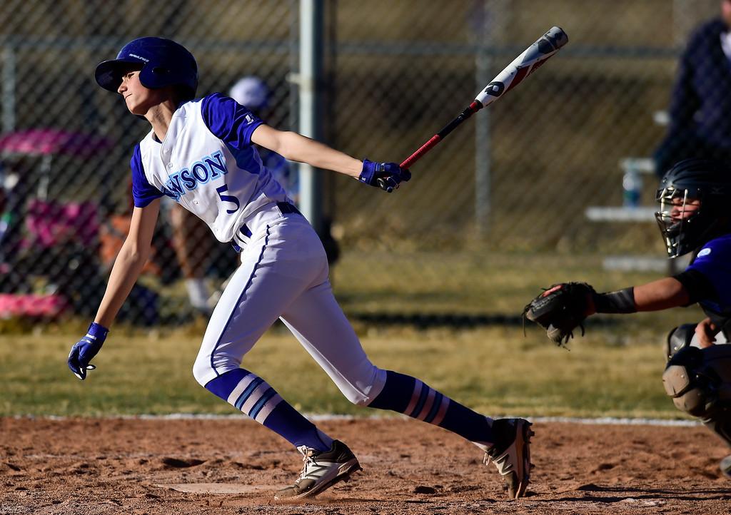 . Dawson School\'s Donovan Muniz (No. 5) gets a base hit  against Peak to Peak High School on Wednesday. More photos: BoCoPreps.com. Matthew Jonas/Staff Photographer March 15,  2017