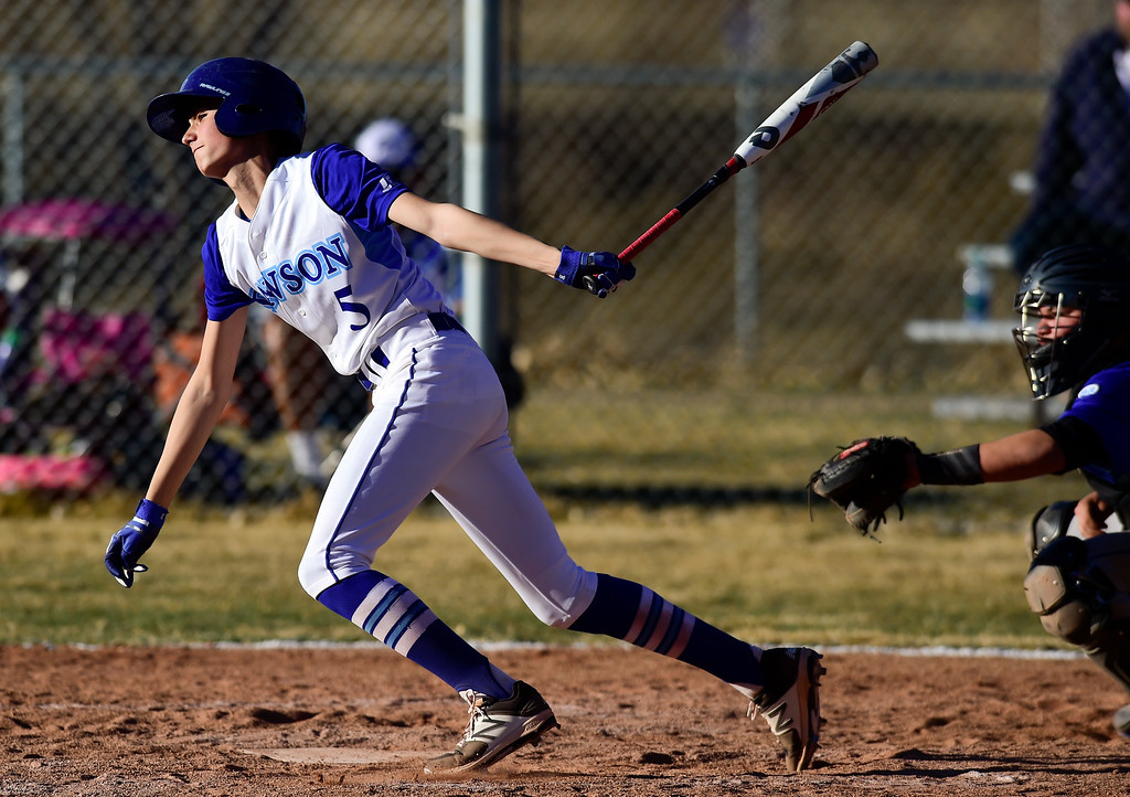 . Dawson School\'s Donovan Muniz (No. 5) gets a base hit  against Peak to Peak High School on Wednesday. More photos: BoCoPreps.com. Matthew Jonas/Staff Photographer March 15,  2017