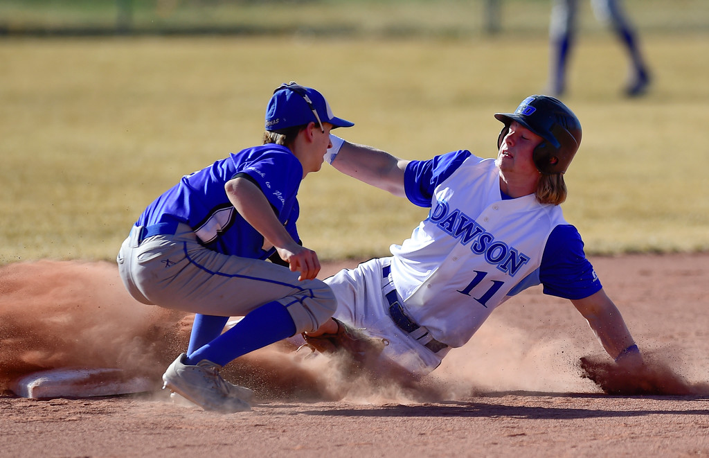 . Dawson School\'s Cade McClellan (No. 11) slides into second as Peak to Peak High School\'s Finn Larson (No. 2) tries to make the tag on Wednesday. More photos: BoCoPreps.com. Matthew Jonas/Staff Photographer March 15,  2017