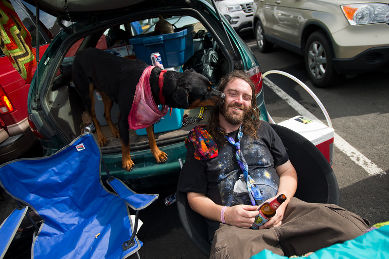 """Jay Leblanc receives a kiss by a dog while waiting for the Dead & Company show at the University of Colorado's Folsom Field in Boulder on Sunday.<br /> More photos:  <a href=""""http://www.dailycamera.com"""">http://www.dailycamera.com</a><br /> (Autumn Parry/Staff Photographer)<br /> July 3, 2016"""