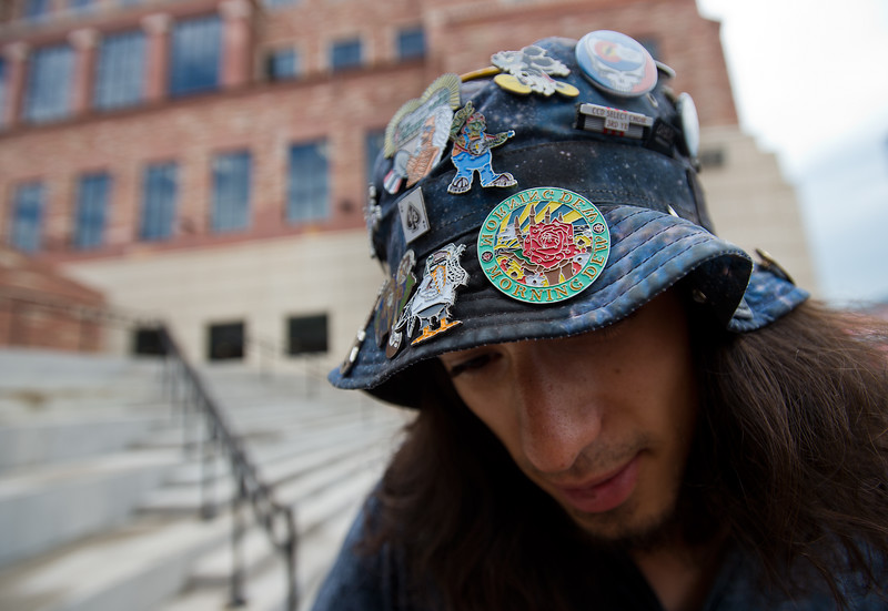 """Damien Kern wears a hat decked out with Grateful Dead pins while he waits in line for the Dead & Company concert at the University of Colorado's Folsom Field in Boulder on Saturday.<br /> More photos:  <a href=""""http://www.dailycamera.com"""">http://www.dailycamera.com</a><br /> (Autumn Parry/Staff Photographer)<br /> July 2, 2016"""
