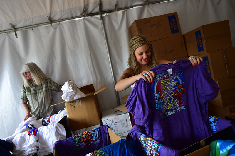 """Caitlin Herasimchuk (right) and Barbara Kuiper, with YFIO Inc., sort through Dead & Company t-shirts that will be for sale during the concert at the University of Colorado's Folsom Field in Boulder on Saturday.<br /> More photos:  <a href=""""http://www.dailycamera.com"""">http://www.dailycamera.com</a><br /> (Autumn Parry/Staff Photographer)<br /> July 2, 2016"""