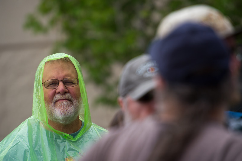 """Gary Houlette, from Oklahoma, wears a poncho to keep himself dry from the rain, while waiting in line for the Dead & Company concert at the University of Colorado's Folsom Field in Boulder on Saturday.<br /> More photos:  <a href=""""http://www.dailycamera.com"""">http://www.dailycamera.com</a><br /> (Autumn Parry/Staff Photographer)<br /> July 2, 2016"""