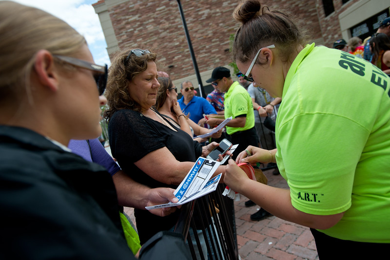"""Karen Konicek gets a wrist band for VIP members prior to the Dead & Company concert at the University of Colorado's Folsom Field in Boulder on Saturday.<br /> More photos:  <a href=""""http://www.dailycamera.com"""">http://www.dailycamera.com</a><br /> (Autumn Parry/Staff Photographer)<br /> July 2, 2016"""