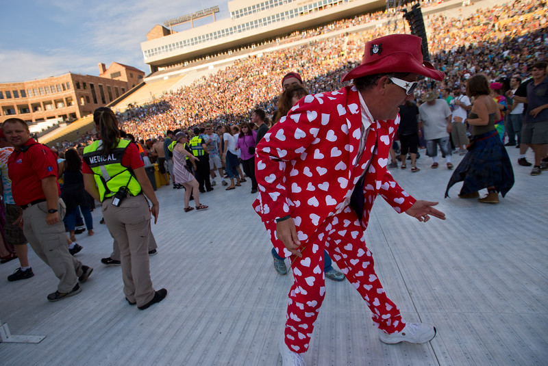 """A concert attendee dances to music by Dead & Company at the University of Colorado's Folsom Field in Boulder on Saturday.<br /> More photos:  <a href=""""http://www.dailycamera.com"""">http://www.dailycamera.com</a><br /> (Autumn Parry/Staff Photographer)<br /> July 2, 2016"""