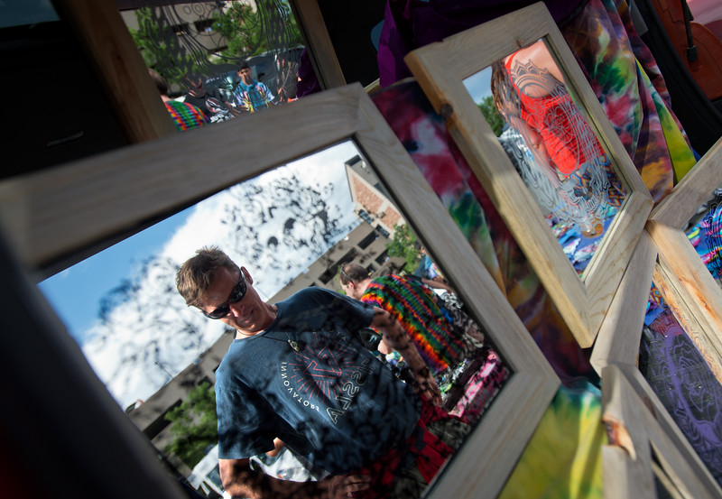 """Jeff Chamberlin, creator of Reflective Conceptions, displays his chemically etched mirrors for sale, prior to the Dead & Company show at the University of Colorado's Folsom Field in Boulder on Sunday.<br /> More photos:  <a href=""""http://www.dailycamera.com"""">http://www.dailycamera.com</a><br /> (Autumn Parry/Staff Photographer)<br /> July 3, 2016"""